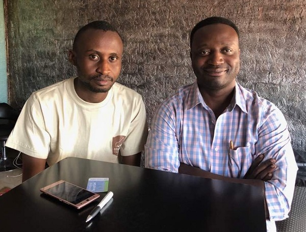 SautiTech Chief Editor Nicholas Asingwire (L) and Lawrence Zikusoka, the CEO of GLICTS