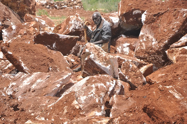 An-elderly-man-protects-his-consignment-of-limestone-rocks-in-a-limestone-mining-site-located-in-Katikitile-Parish-Tapac-Sub-County-Moroto-district