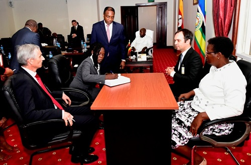 Evelyne Anite, investment minister on behalf of Uganda government signing the joint venture agreement between Uganda Printing and Publishing Corporation and Veridos Identity Solution, a Germany company