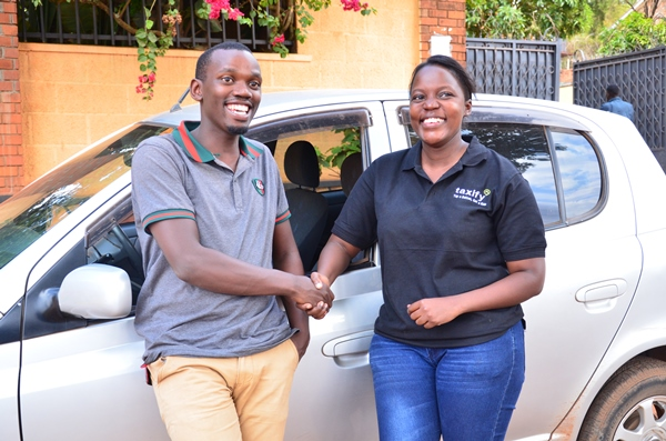 Julian Byamugisha with a Bolt Uganda driver