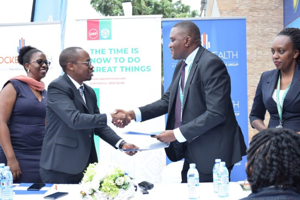 tmcg boss and uap director shaking hands