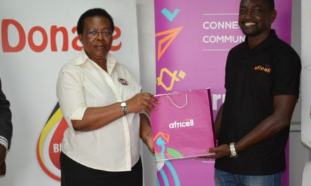Dr_Dorothy_Nakyeyune UBTS Executive_Director_Receives_Donation_From Africell PRO Edgar Karamag